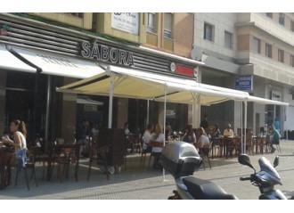 Store double pente pour abri terrasse toile micro-perforée PVC Soltis